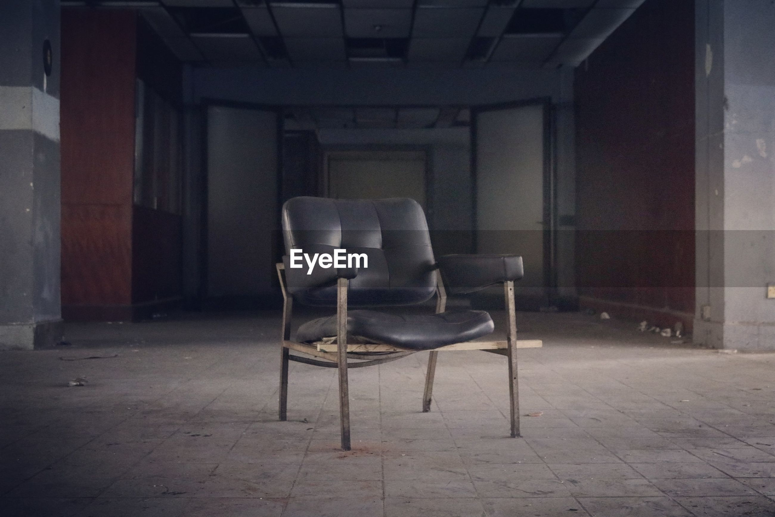 EMPTY CHAIRS IN ROOM