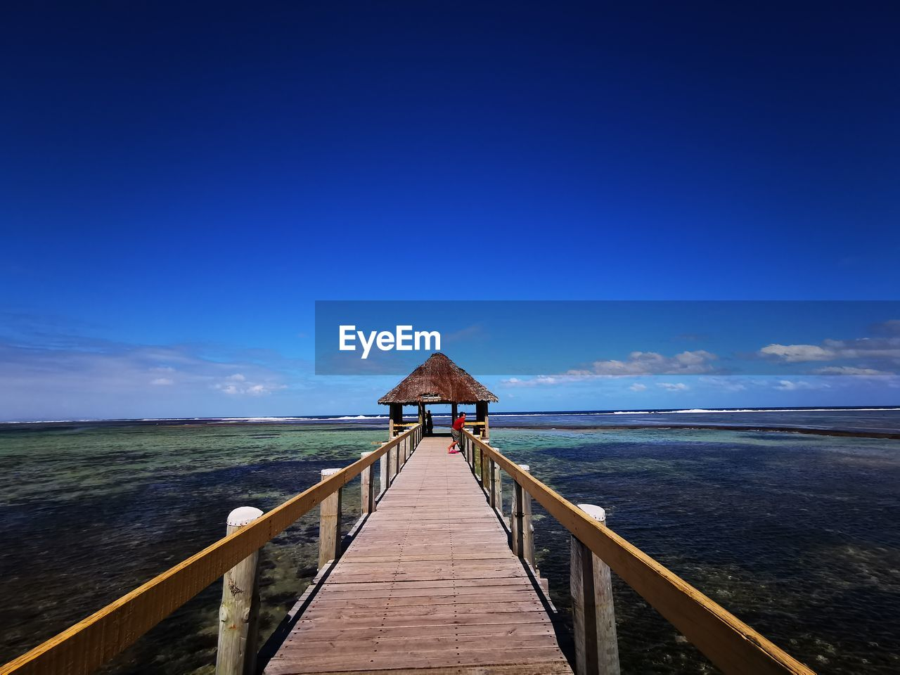 sky, water, sea, blue, beauty in nature, scenics - nature, horizon, pier, horizon over water, tranquility, tranquil scene, the way forward, railing, wood - material, architecture, built structure, nature, direction, idyllic, no people, outdoors, wood paneling, long