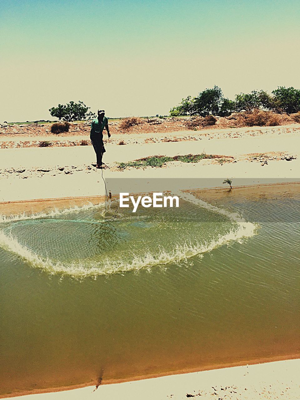 full length, real people, one person, sand, water, men, clear sky, leisure activity, beach, outdoors, day, nature, motion, lifestyles, jumping, scenics, beauty in nature, sea, one man only, sky, people