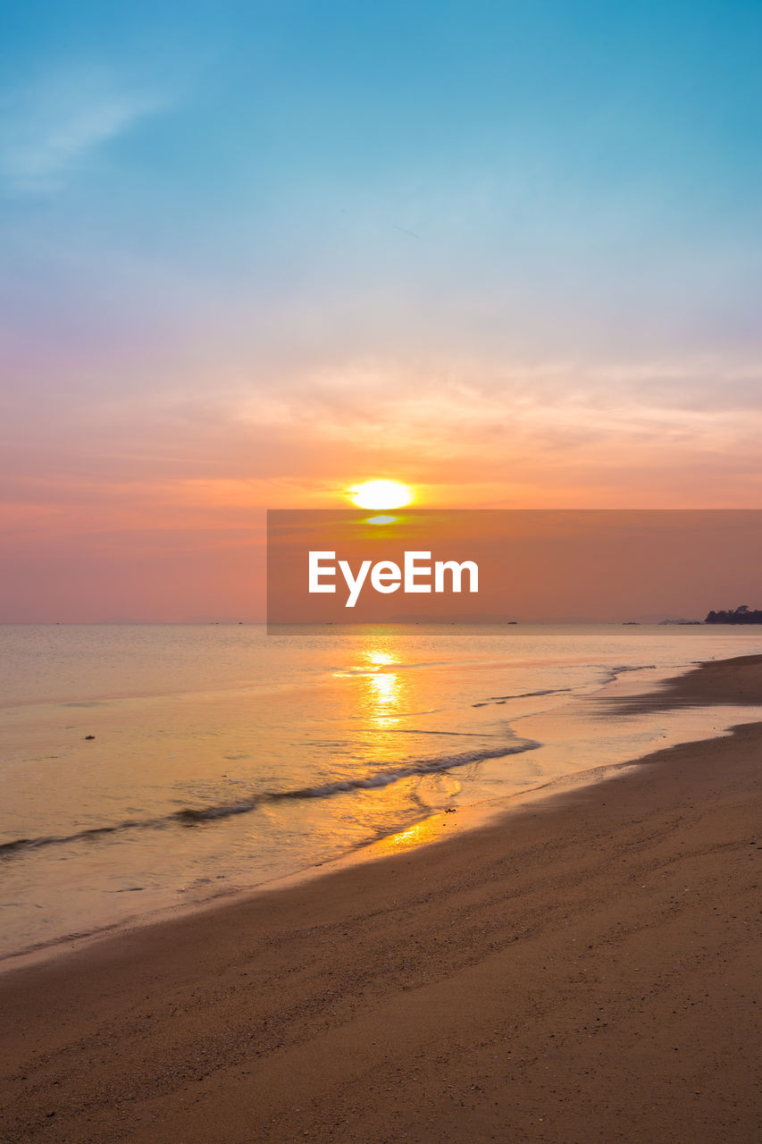 sunset, sky, scenics - nature, beauty in nature, beach, land, sea, water, horizon over water, horizon, tranquility, orange color, tranquil scene, idyllic, sand, cloud - sky, nature, motion, non-urban scene, sun, no people, outdoors