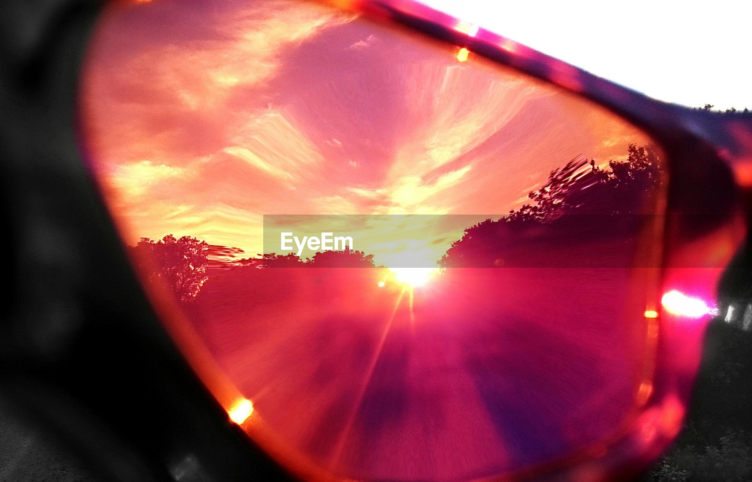 sun, sunset, lens flare, sunbeam, sunlight, tree, sky, orange color, red, part of, transparent, car, glass - material, reflection, transportation, nature, close-up, one person, beauty in nature, sunglasses