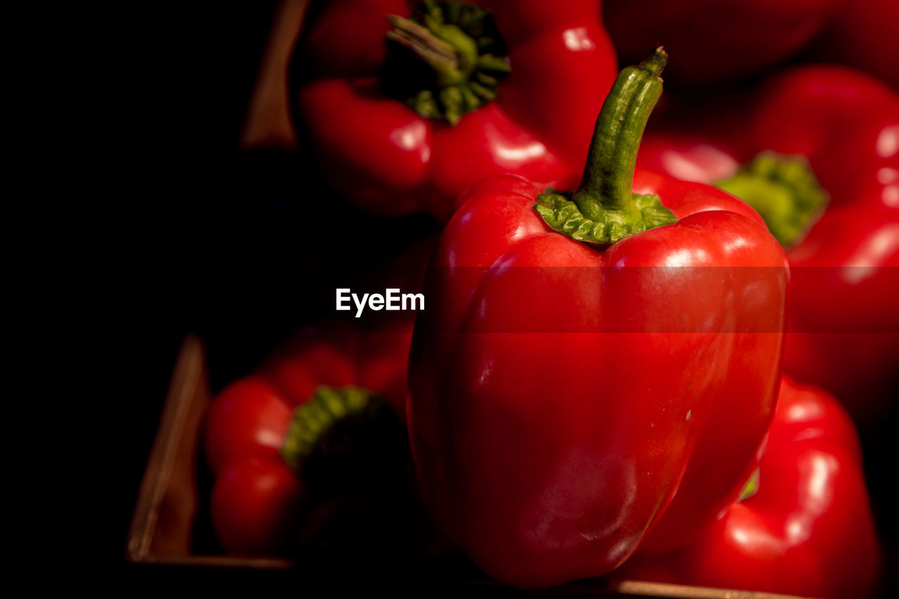 CLOSE-UP OF RED BELL PEPPERS AND TOMATOES