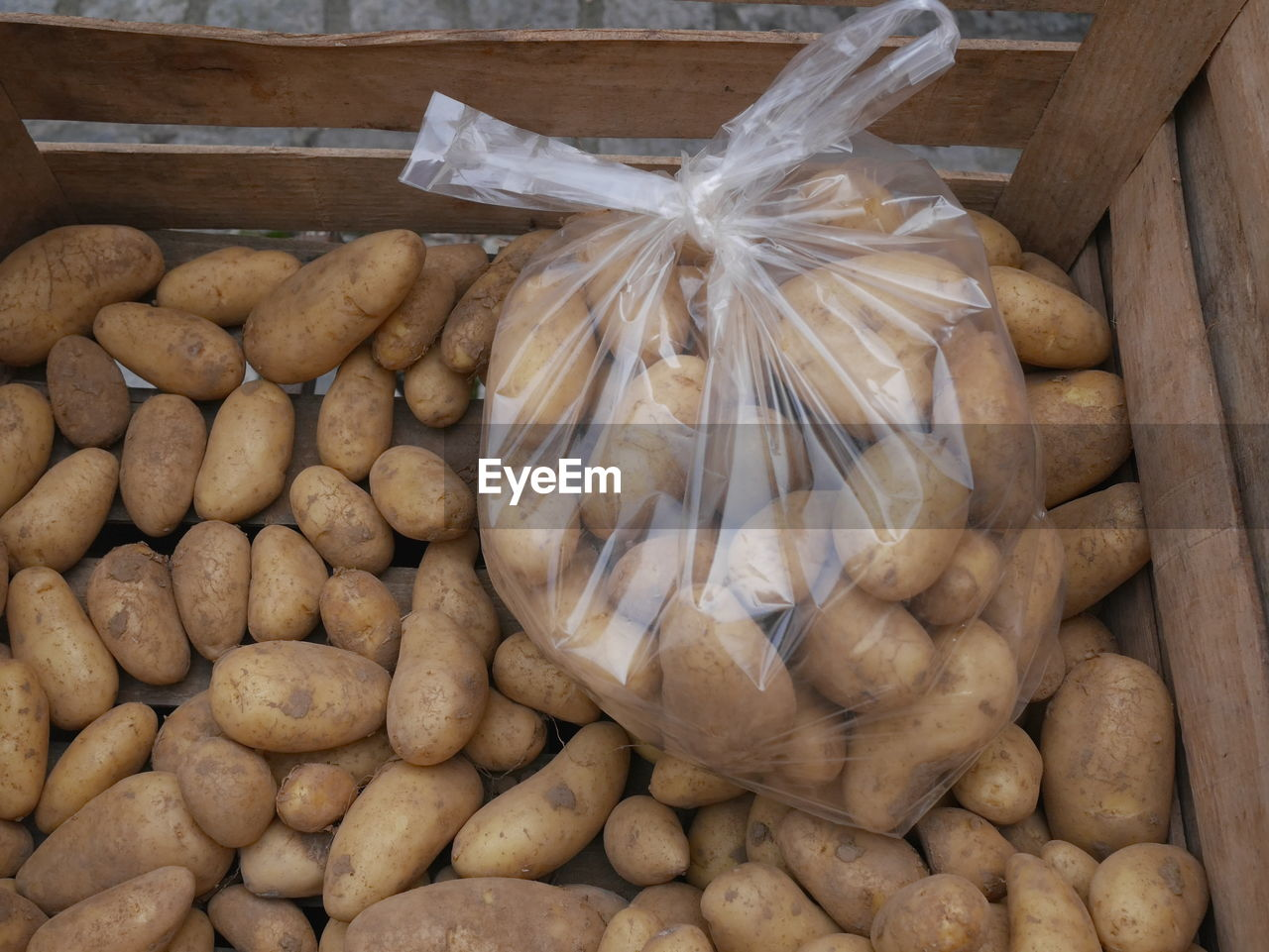 High Angle View Of Potatoes In Plastic Bag For Sale At Market