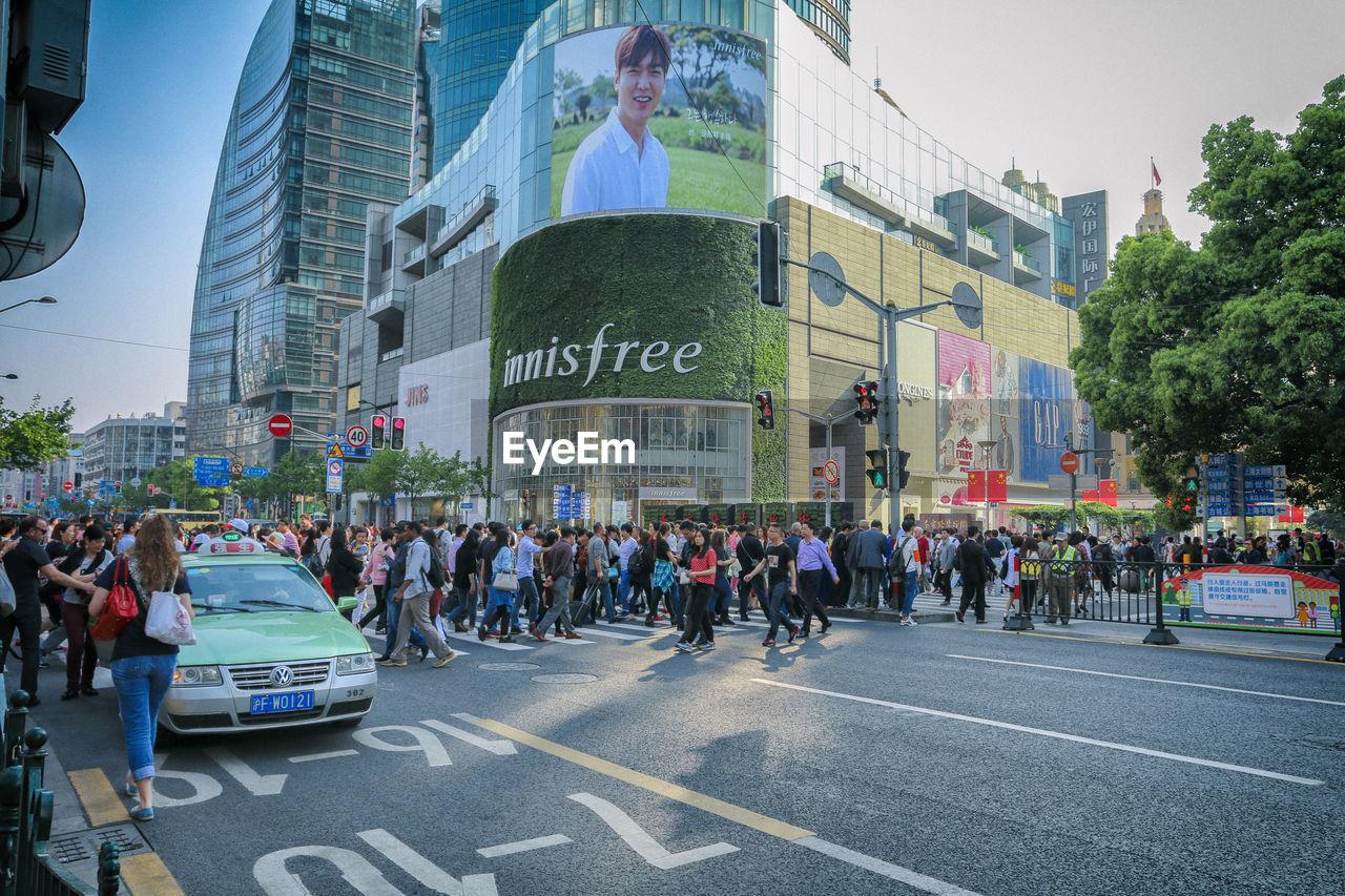 CROWD ON CITY STREET
