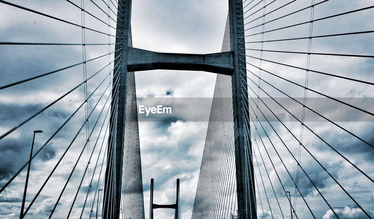 Low Angle View Of Severn Bridge Against Cloudy Sky