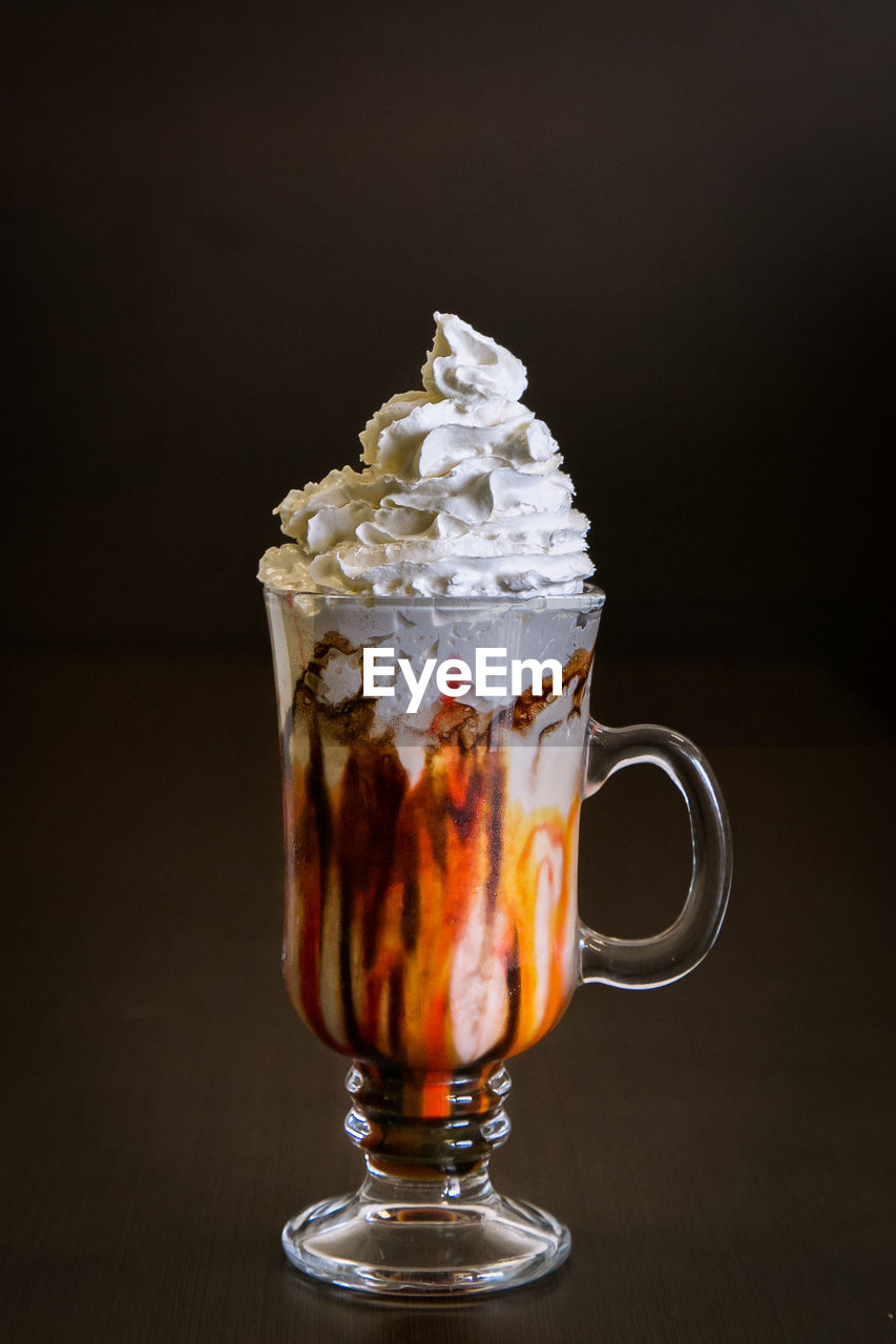 Close-Up Of Iced Coffee Against Black Background