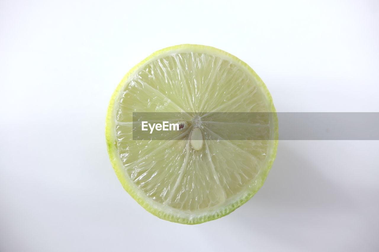 fruit, healthy eating, food, food and drink, freshness, studio shot, citrus fruit, wellbeing, white background, lemon, close-up, slice, no people, indoors, green color, still life, cross section, lime, single object, copy space