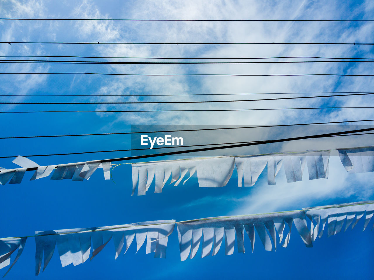 blue, day, no people, nature, low angle view, sky, outdoors, architecture, cable, reflection, pattern, transportation, water, window, mode of transportation, sunlight, drying, hanging, metal, laundry