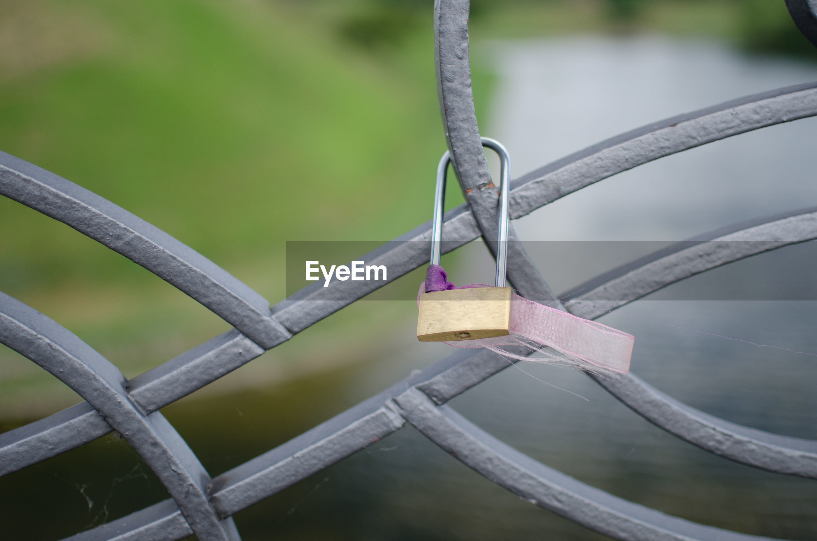 Close-up of padlock on railing