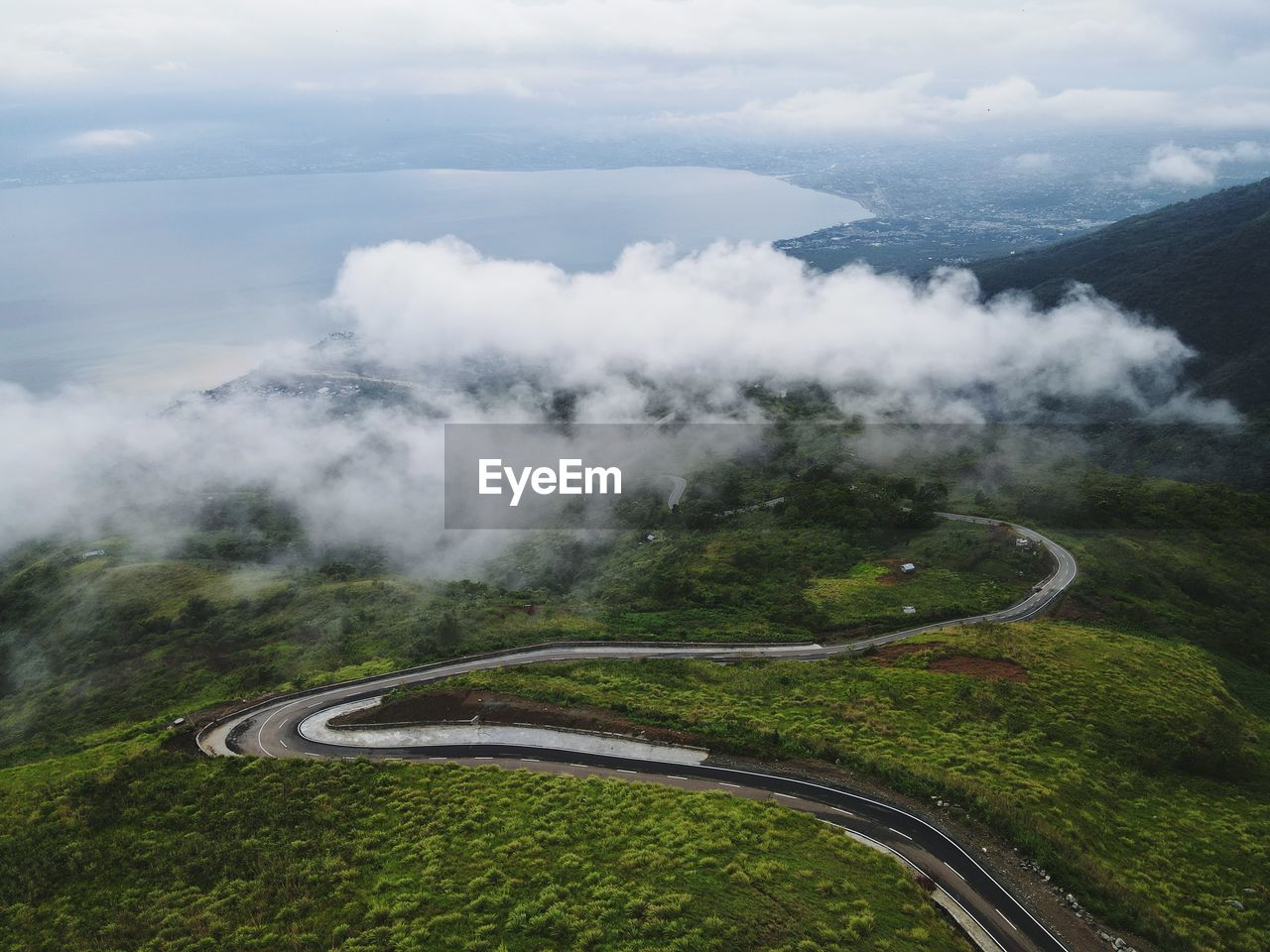 AERIAL VIEW OF ROAD AMIDST LAND AGAINST SKY