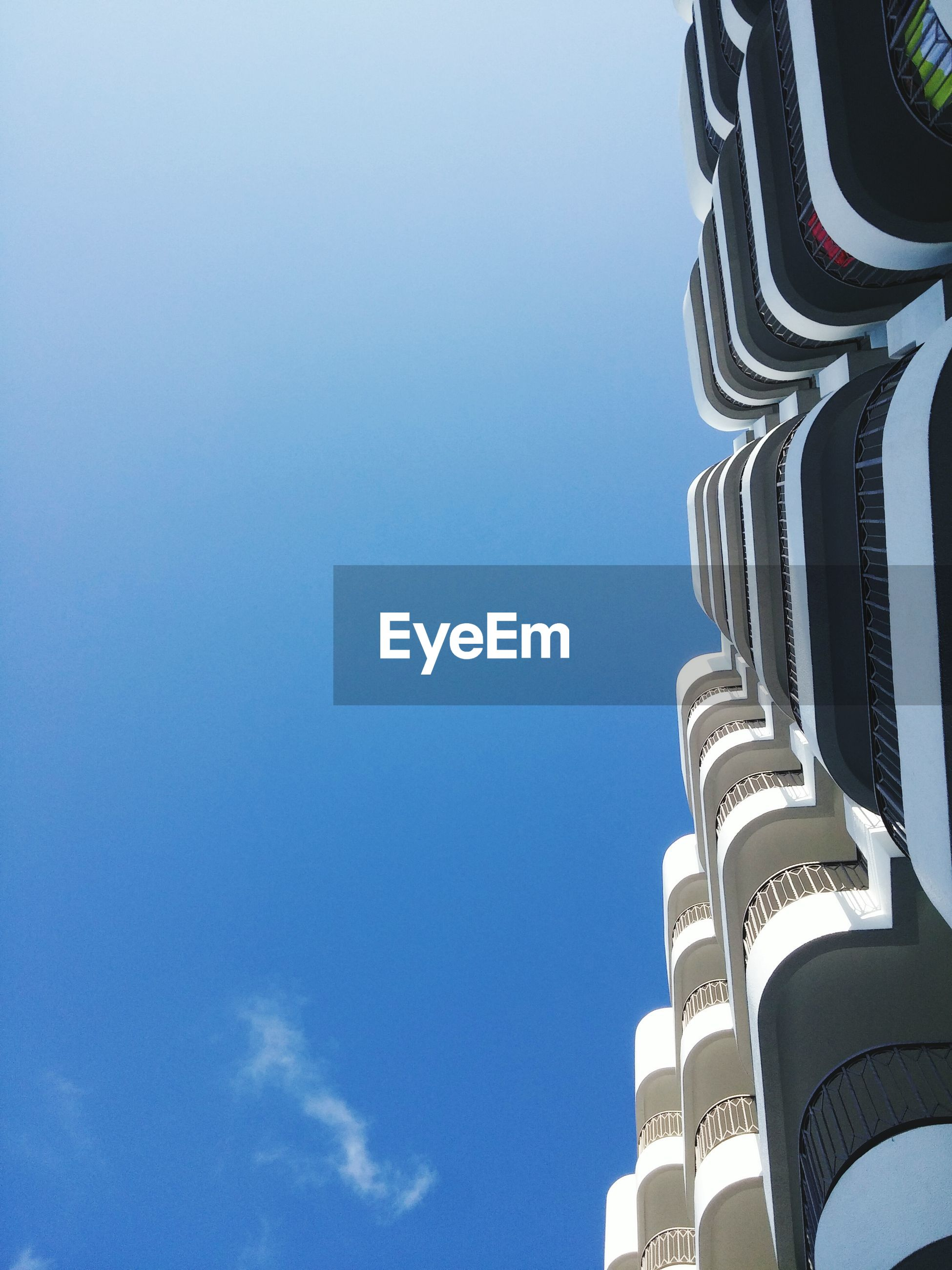 low angle view, building exterior, architecture, built structure, clear sky, blue, copy space, tall - high, skyscraper, tower, city, modern, building, office building, high section, day, sky, outdoors, no people, tall