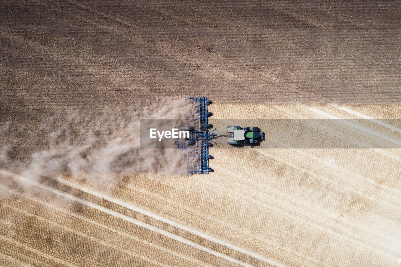 High Angle View Of Combine Harvester On Agricultural Field