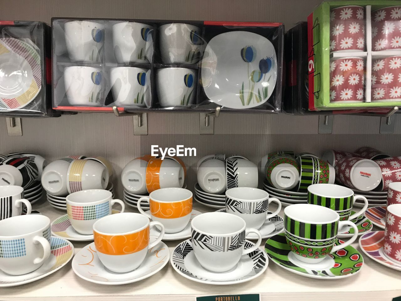 cup, large group of objects, plate, arrangement, crockery, choice, mug, ceramics, shelf, food and drink, still life, no people, container, variation, saucer, drink, indoors, kitchen utensil, tea cup, bowl, order, glass, teapot