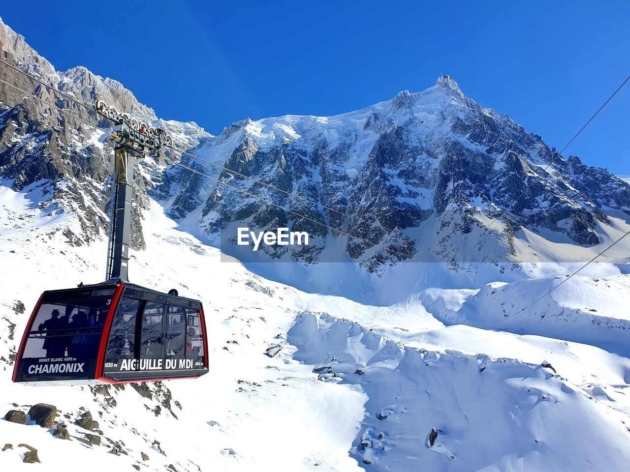 snow, winter, cold temperature, mountain, snowcapped mountain, scenics - nature, beauty in nature, sky, cable car, nature, mountain range, white color, mode of transportation, non-urban scene, day, tranquil scene, transportation, frozen, covering, formation, extreme weather
