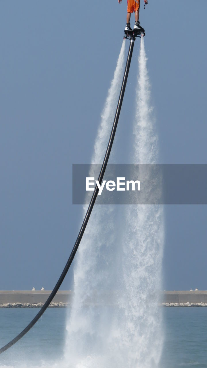 Person Flyboarding In Sea