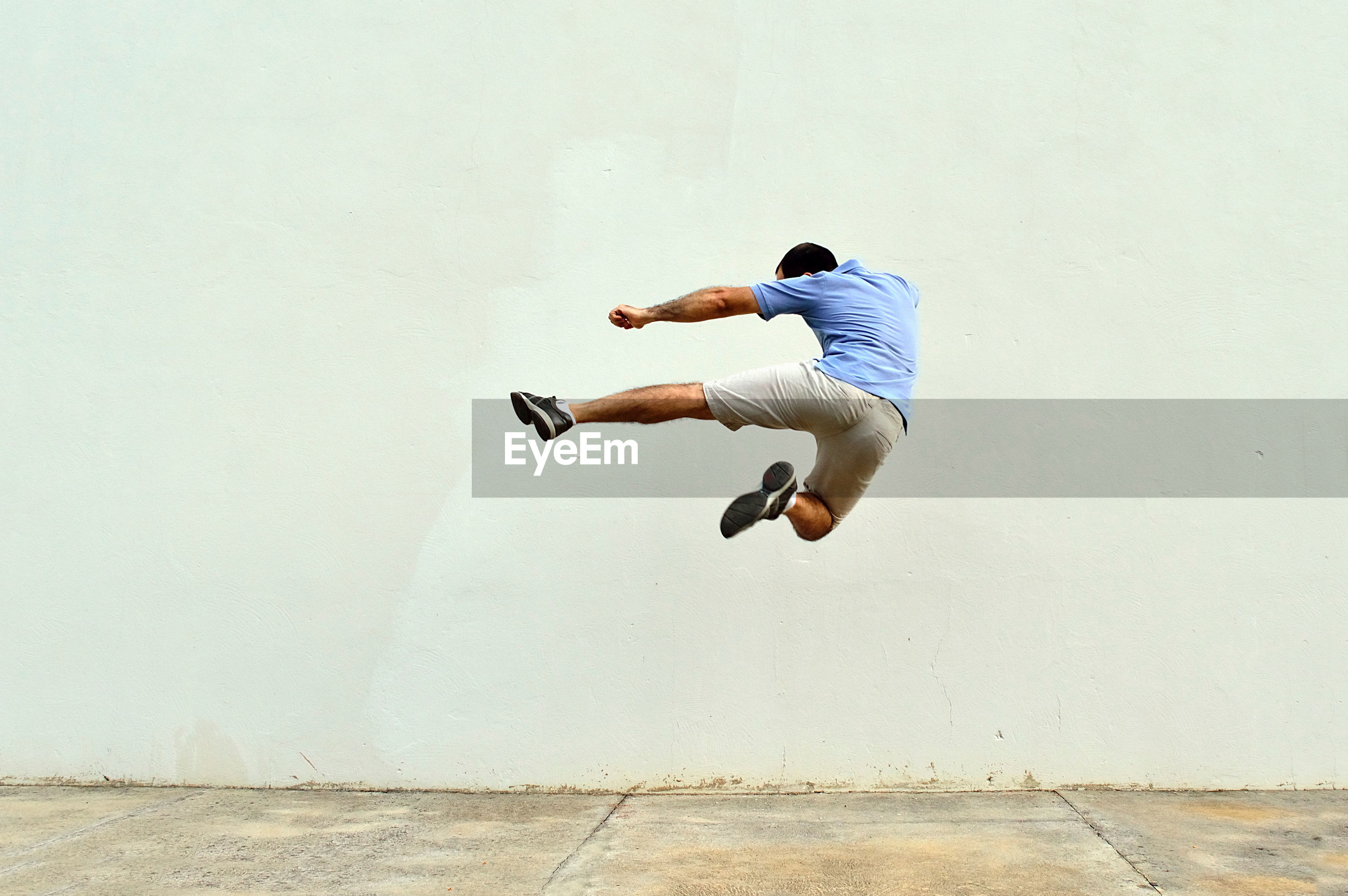 Man doing a flying kick