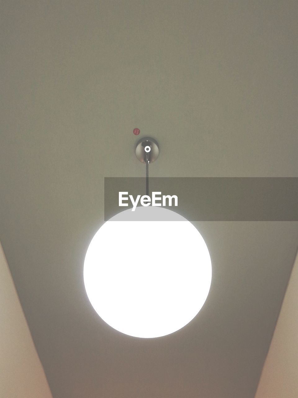 Low angle view of pendant light hanging on ceiling