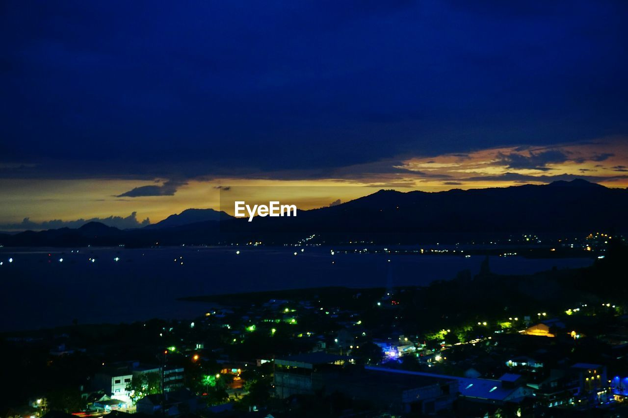 illuminated, sky, cloud - sky, architecture, night, city, building exterior, built structure, no people, nature, high angle view, water, cityscape, scenics - nature, mountain, beauty in nature, outdoors, dusk, blue, light