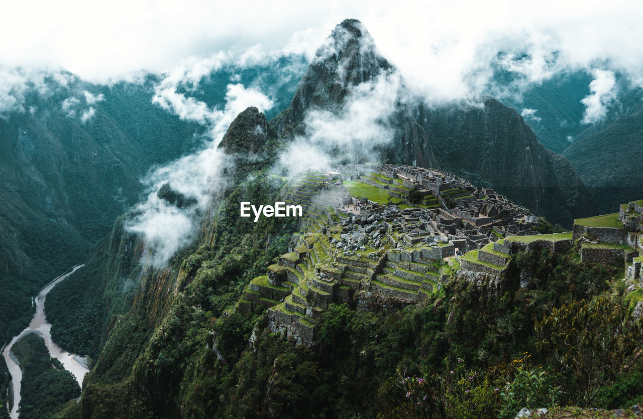 Low angle view of machu picchu against sky