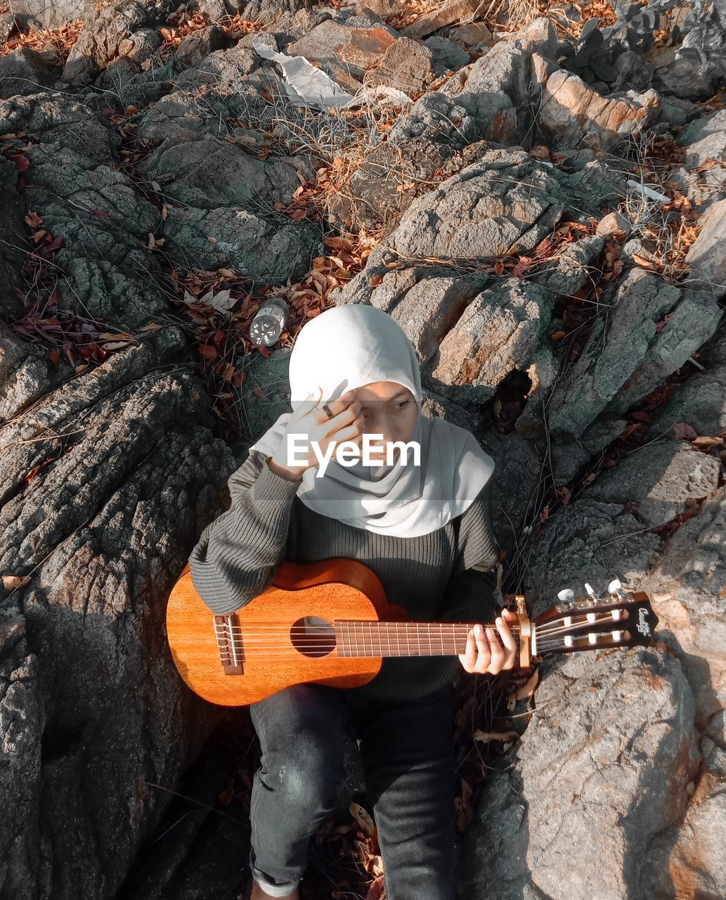 FULL LENGTH OF A PLAYING GUITAR