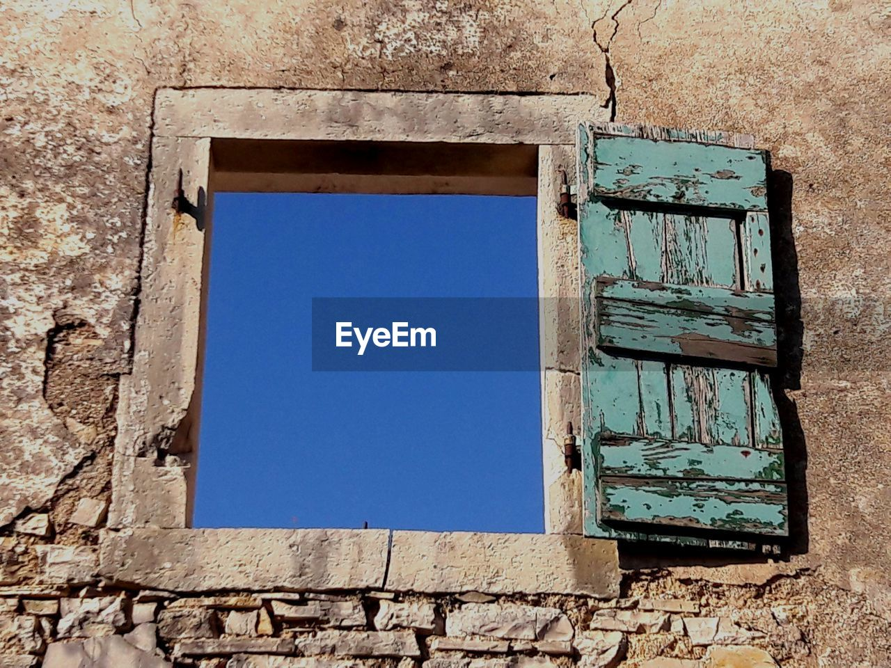 architecture, built structure, window, building exterior, no people, day, wall - building feature, wall, damaged, building, old, abandoned, low angle view, blue, house, outdoors, broken, clear sky, sky, rectangle, deterioration, window frame