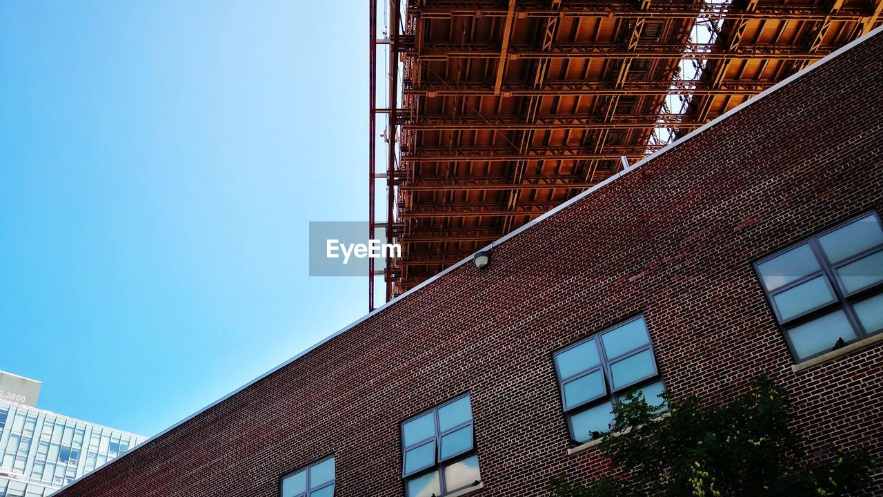architecture, built structure, building exterior, building, low angle view, sky, city, day, no people, nature, office, modern, office building exterior, clear sky, window, outdoors, brick, blue, brick wall, glass - material, skyscraper