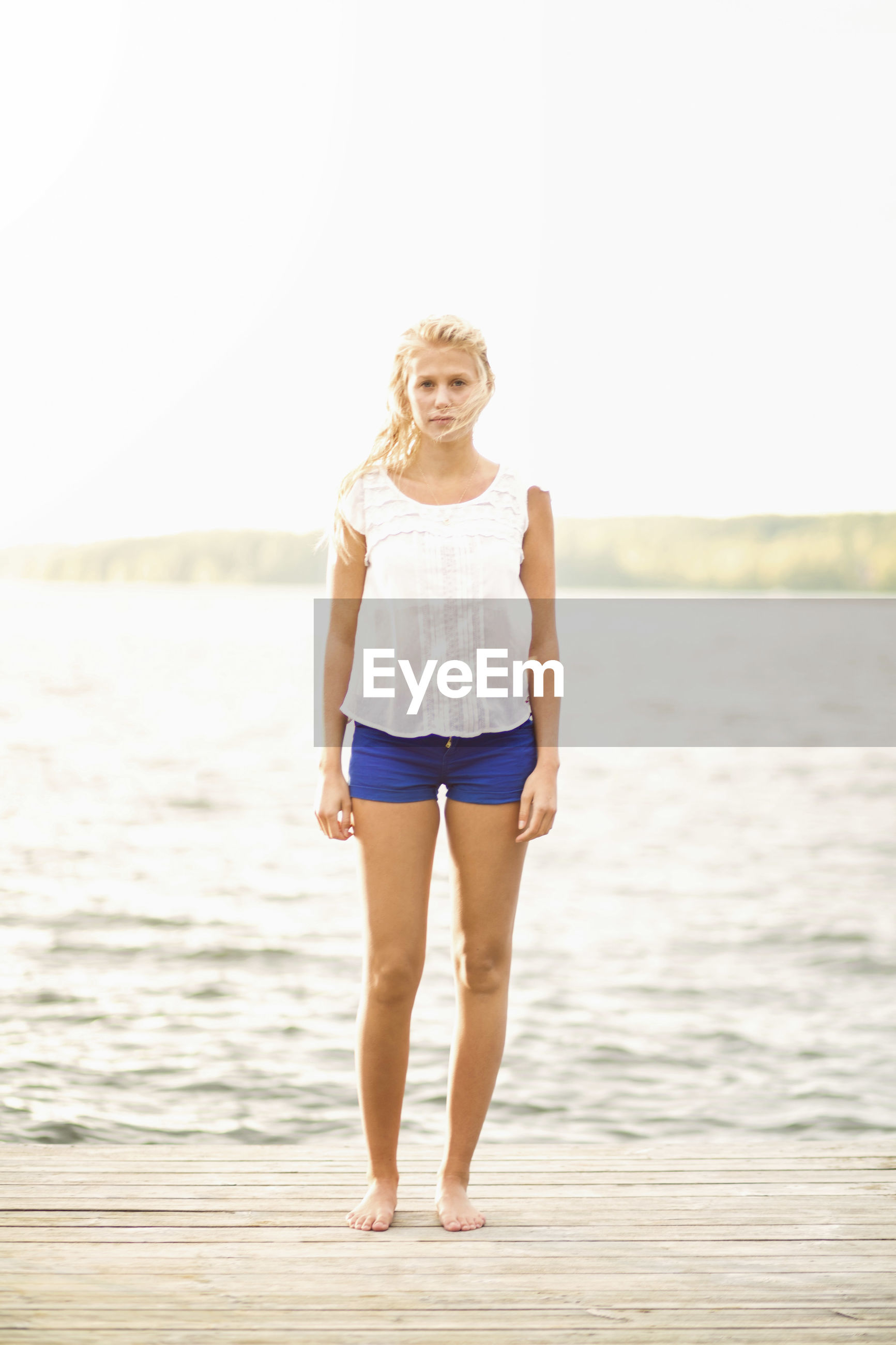 FULL LENGTH PORTRAIT OF WOMAN STANDING IN SEA