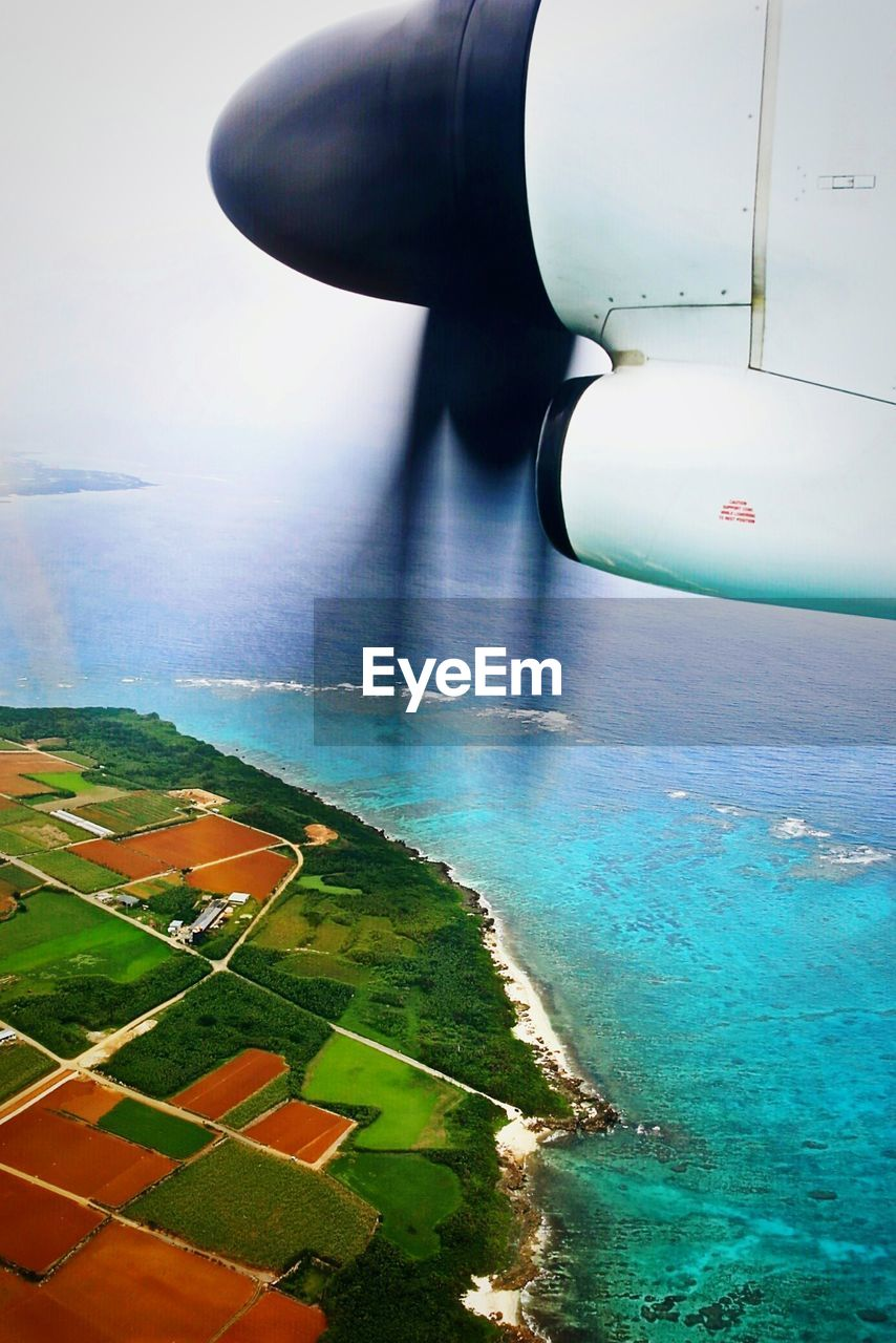air vehicle, water, mode of transportation, airplane, transportation, landscape, flying, aerial view, scenics - nature, nature, beauty in nature, day, land, no people, environment, travel, aircraft wing, sky, outdoors, jet engine