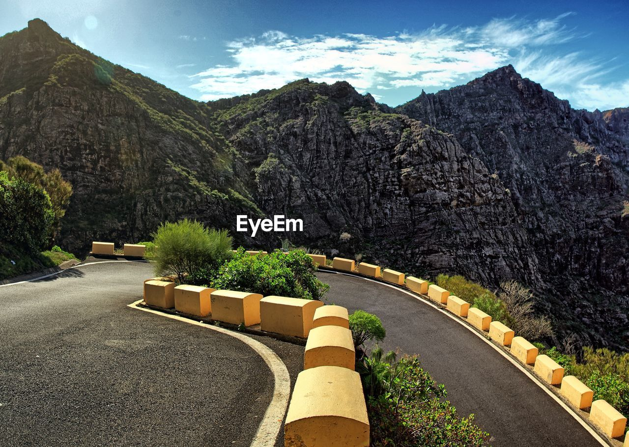 mountain, road, the way forward, day, sky, mountain range, scenics, tree, outdoors, nature, no people, cloud - sky, beauty in nature, winding road, mountain road, landscape