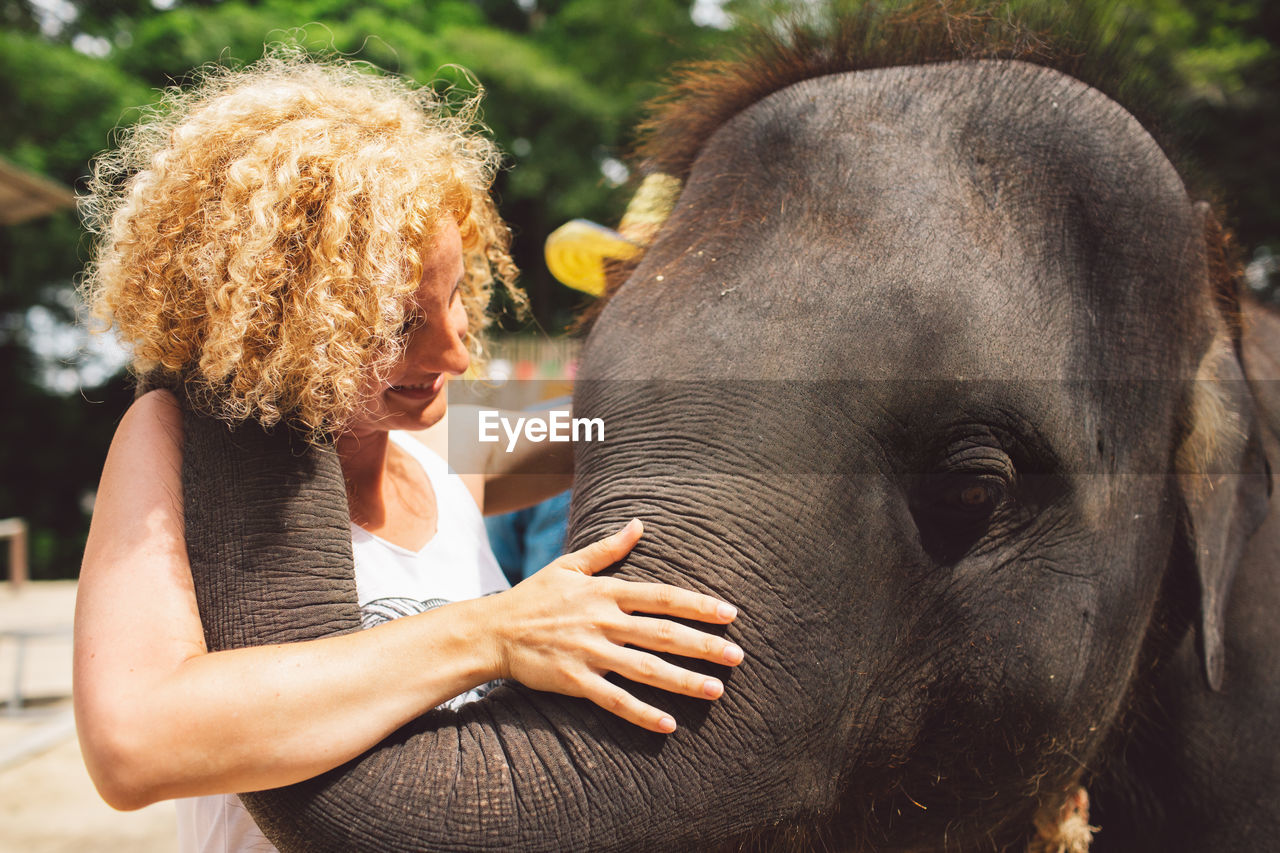 Smiling Woman With Elephant