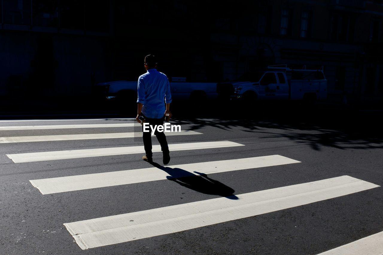 Man walking on zebra crossing