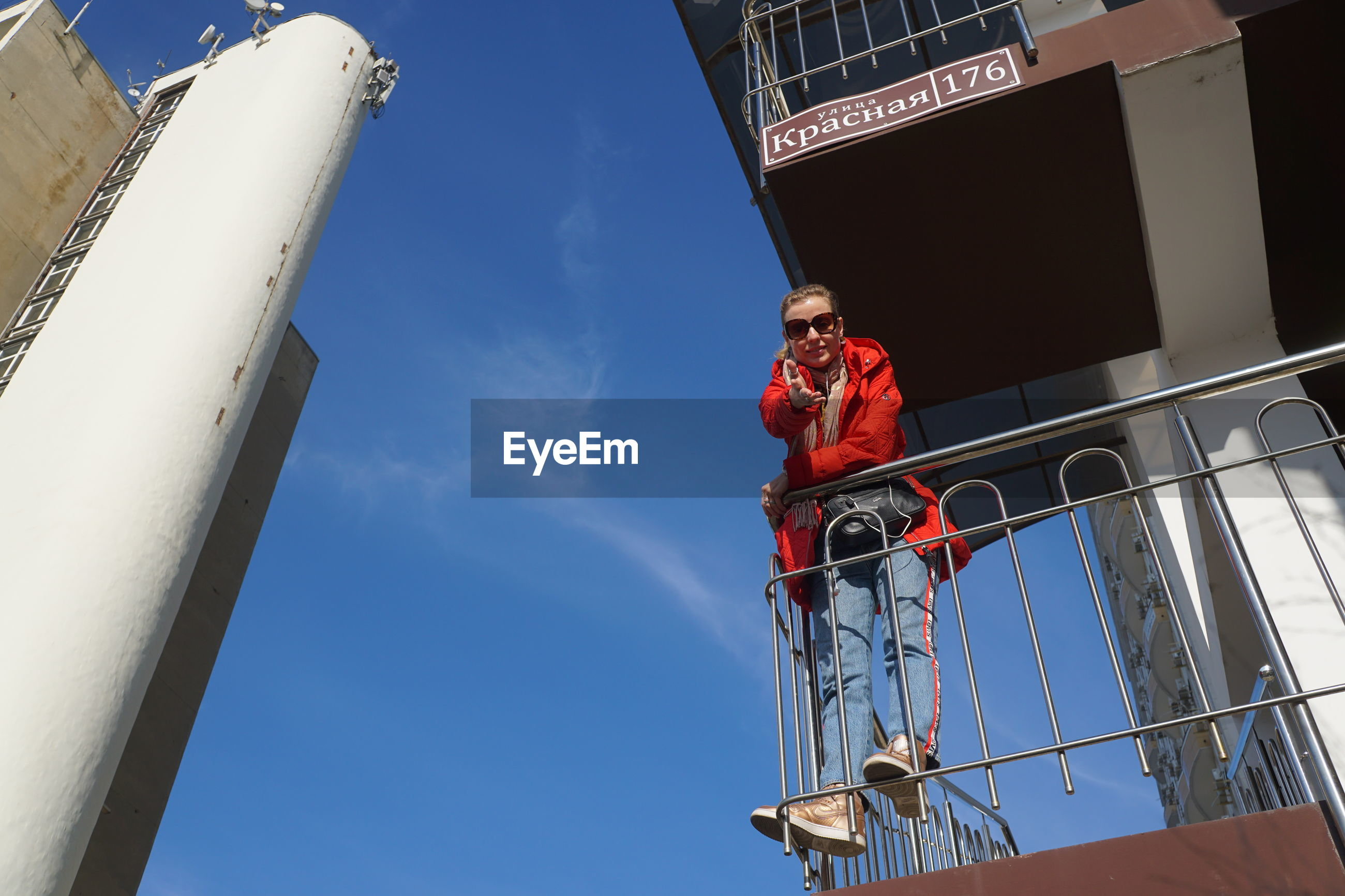 Low angle view of woman standing in balcony
