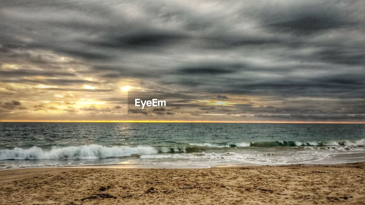 sea, beauty in nature, water, cloud - sky, nature, beach, scenics, sky, sunset, tranquility, horizon over water, tranquil scene, no people, idyllic, sand, outdoors, storm cloud, wave, day