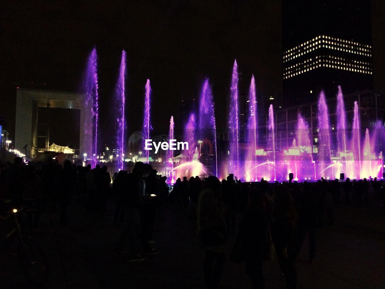 Illuminated Fountains During Night At La Defense