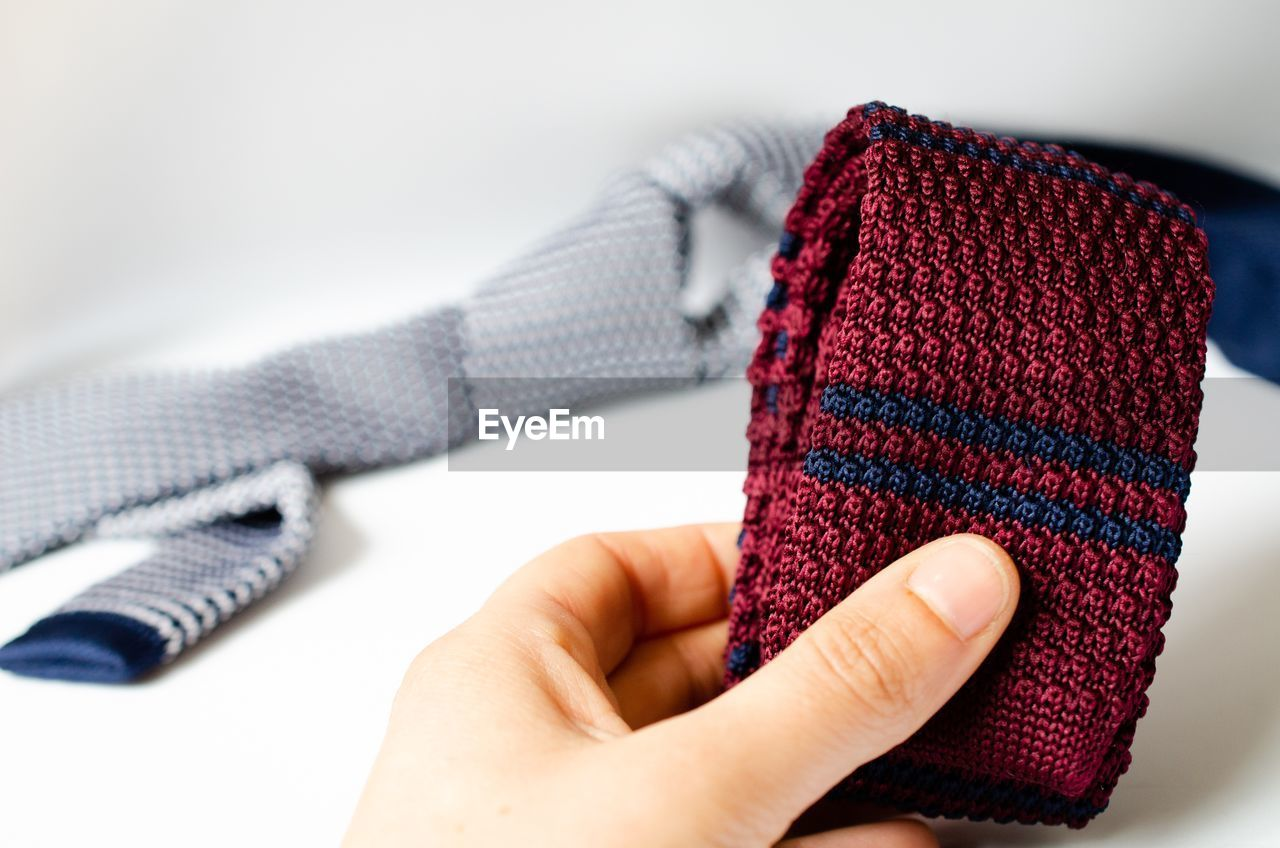 Close-up of hand holding textile