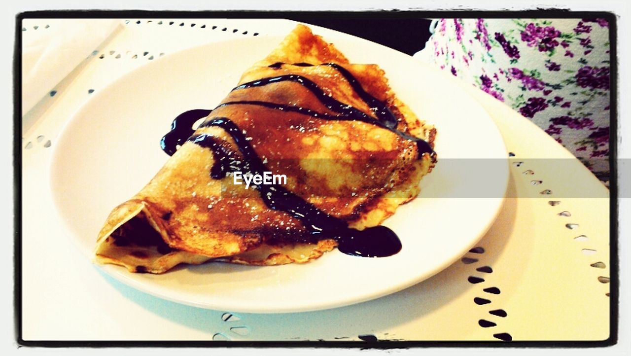 Pancake With Syrup On Plate