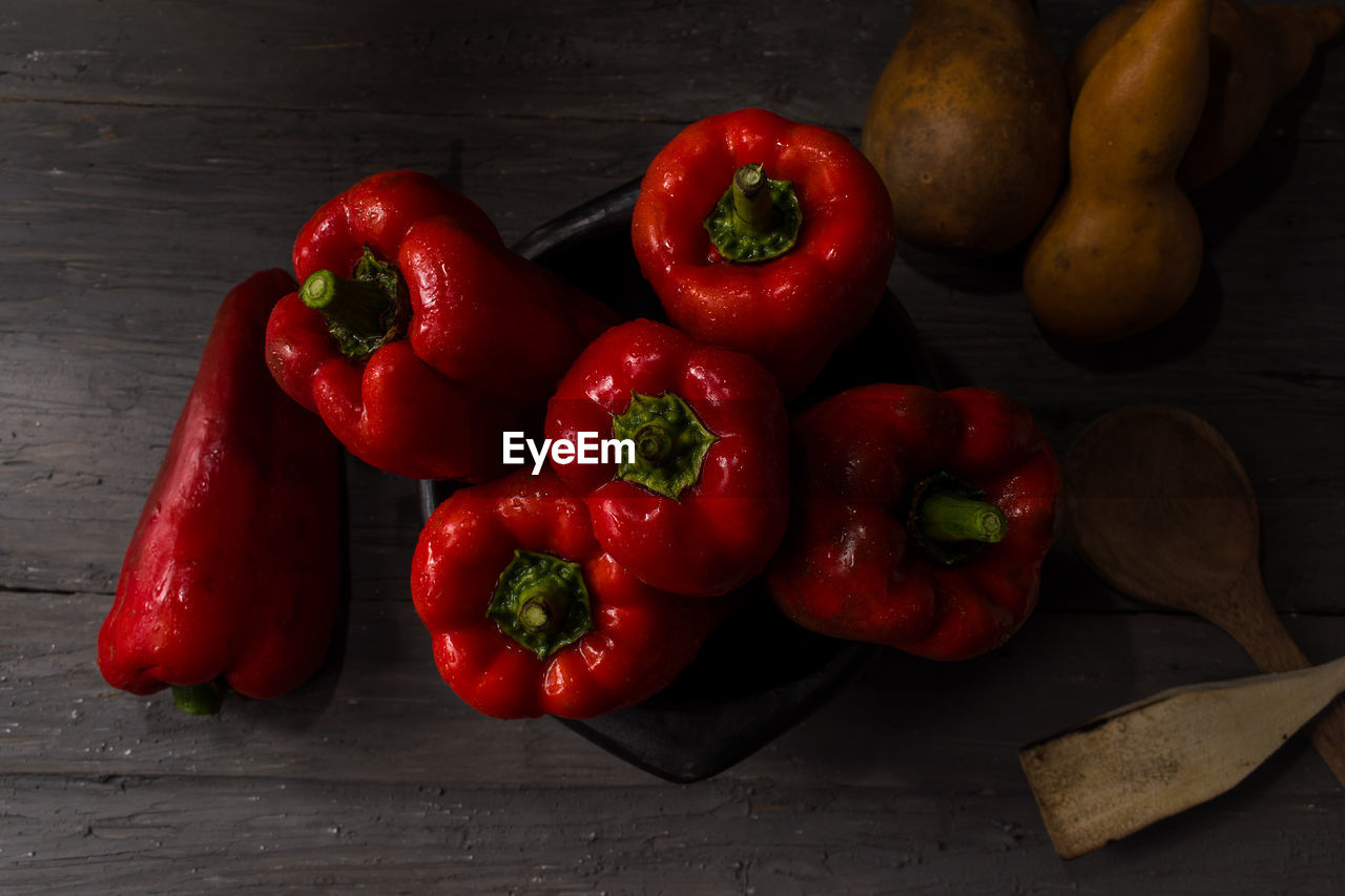 HIGH ANGLE VIEW OF RED CHILI PEPPERS AND VEGETABLES ON TABLE