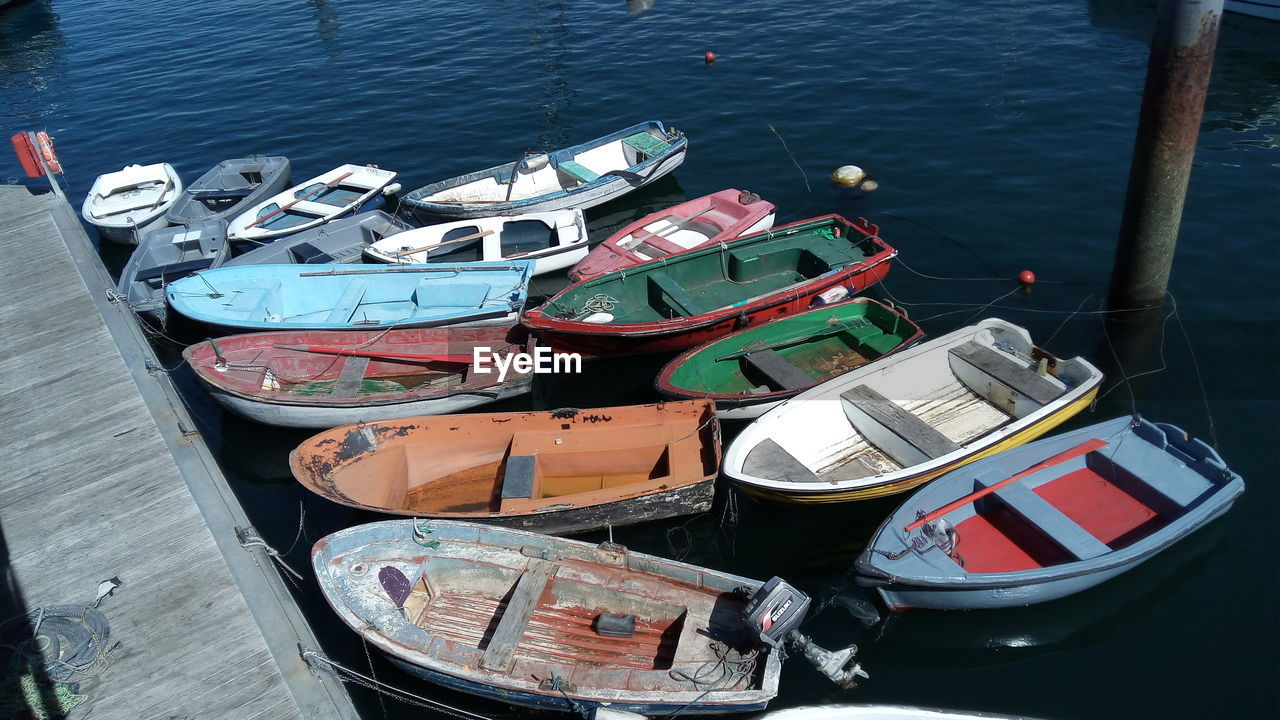 water, nautical vessel, transportation, mode of transportation, high angle view, moored, no people, nature, day, lake, outdoors, harbor, container, pier, food and drink, large group of objects, wood - material, travel, rowboat, fishing boat
