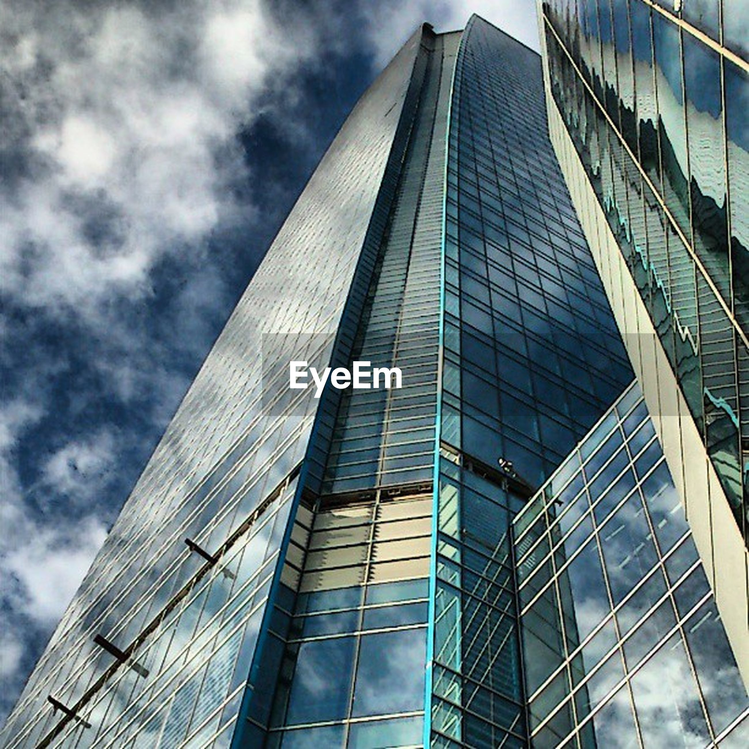 architecture, modern, building exterior, skyscraper, built structure, office building, low angle view, tall - high, city, reflection, tower, glass - material, sky, building, cloud - sky, tall, glass, cloud, office block, day