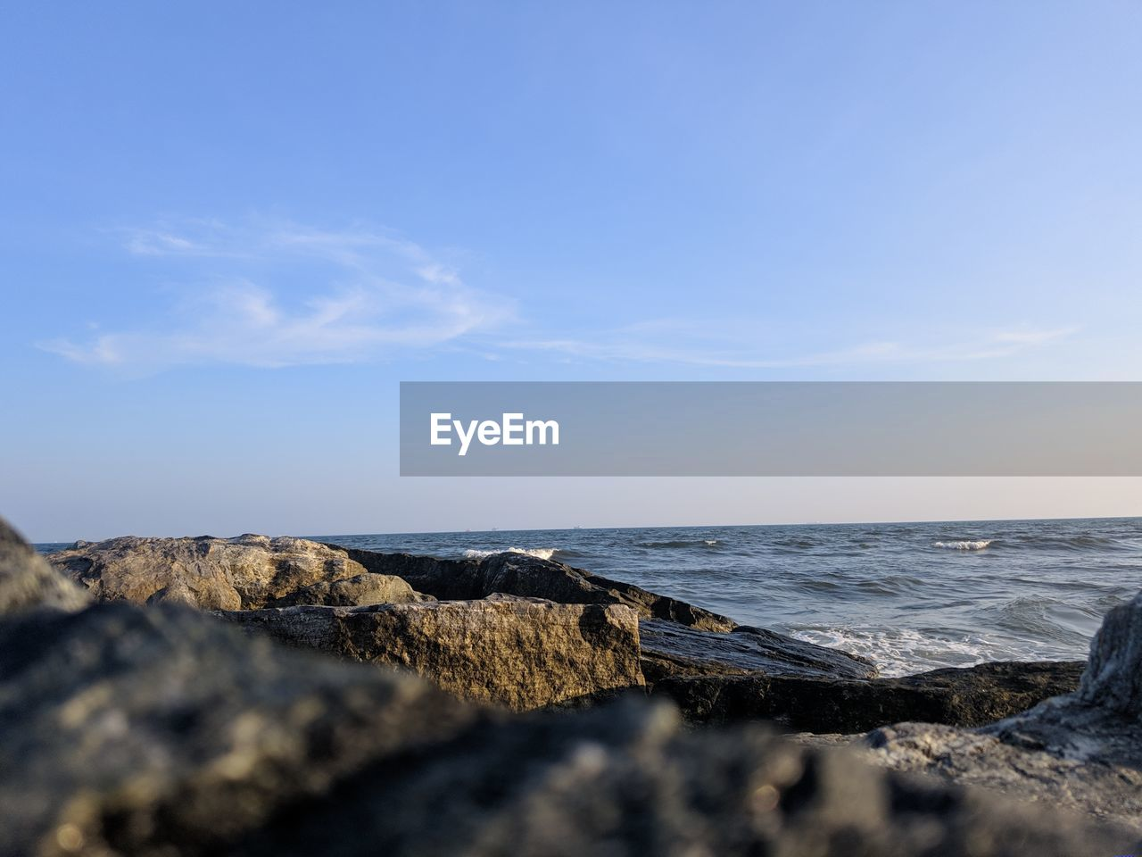 sea, sky, water, scenics - nature, beauty in nature, rock, solid, rock - object, land, beach, horizon over water, tranquility, tranquil scene, nature, horizon, no people, day, blue, cloud - sky, outdoors, rocky coastline