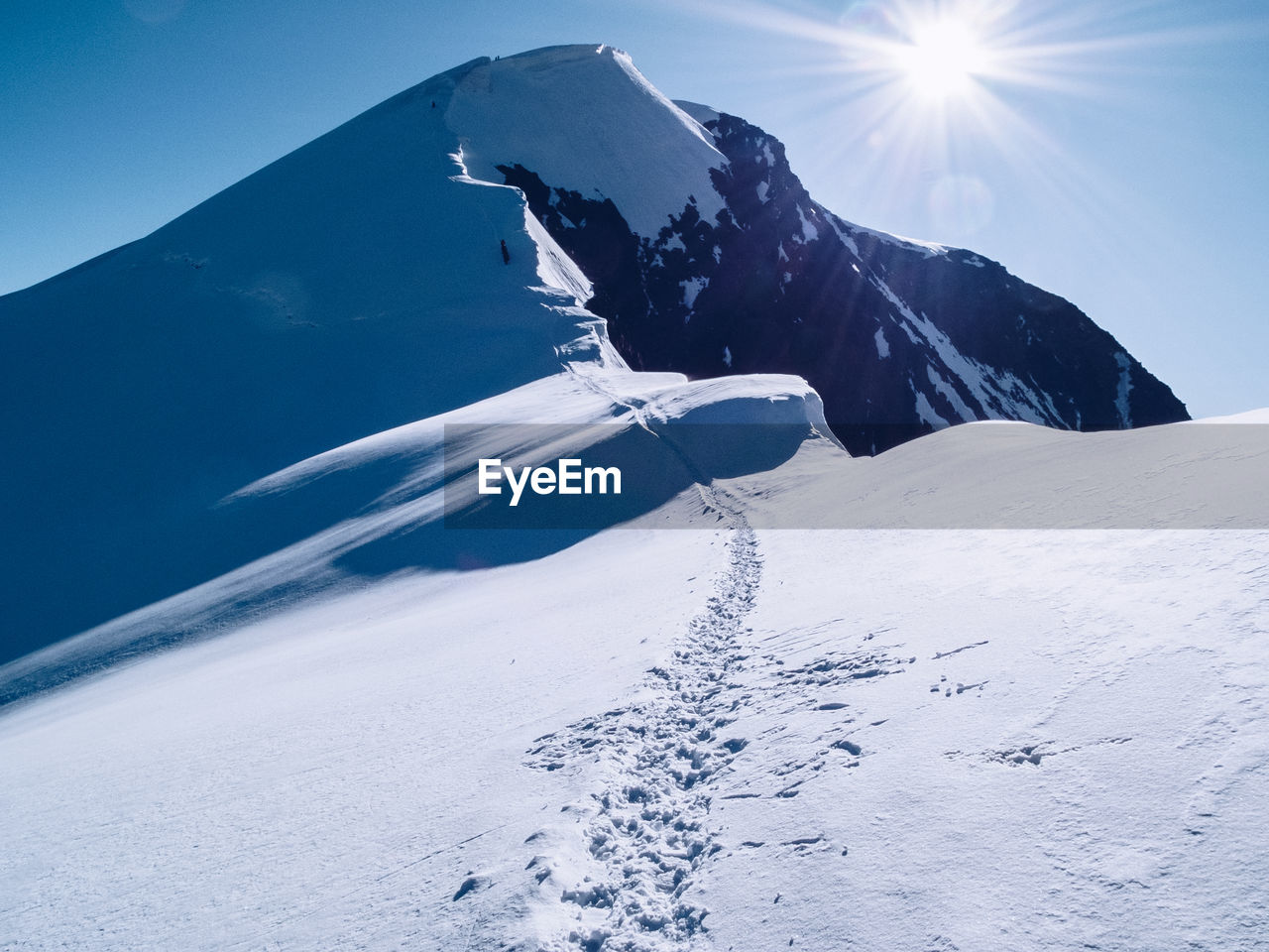 Scenic View Of Snowcapped Mountain Against Bright Sky
