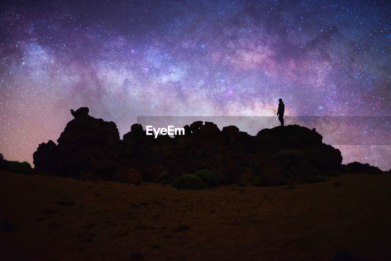 sky, beauty in nature, night, star - space, scenics - nature, space, nature, silhouette, low angle view, land, tranquil scene, astronomy, star, galaxy, rock, rock - object, tranquility, star field, solid, environment, no people, outdoors, milky way
