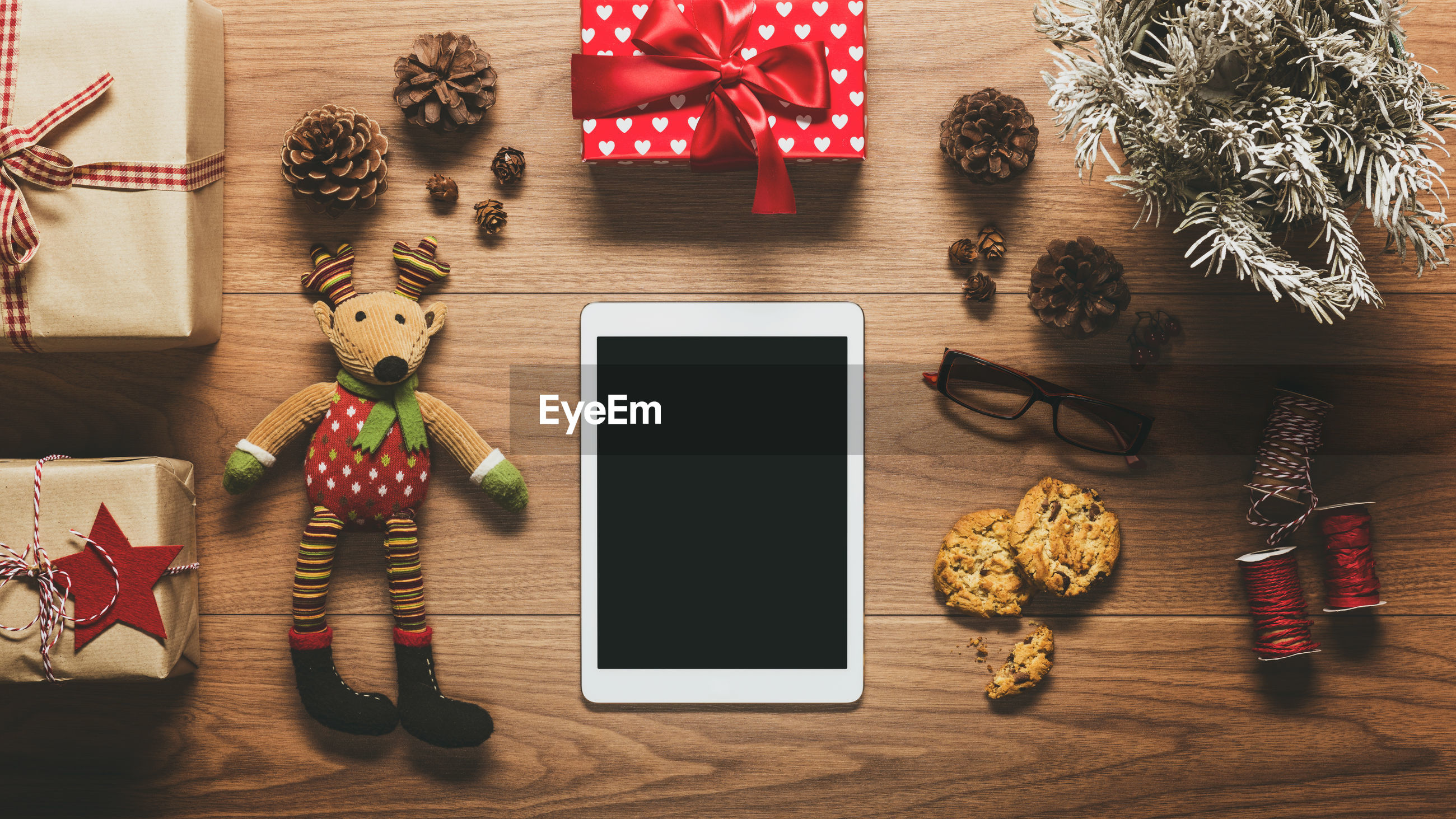 High angle view of christmas decoration with digital tablet on table