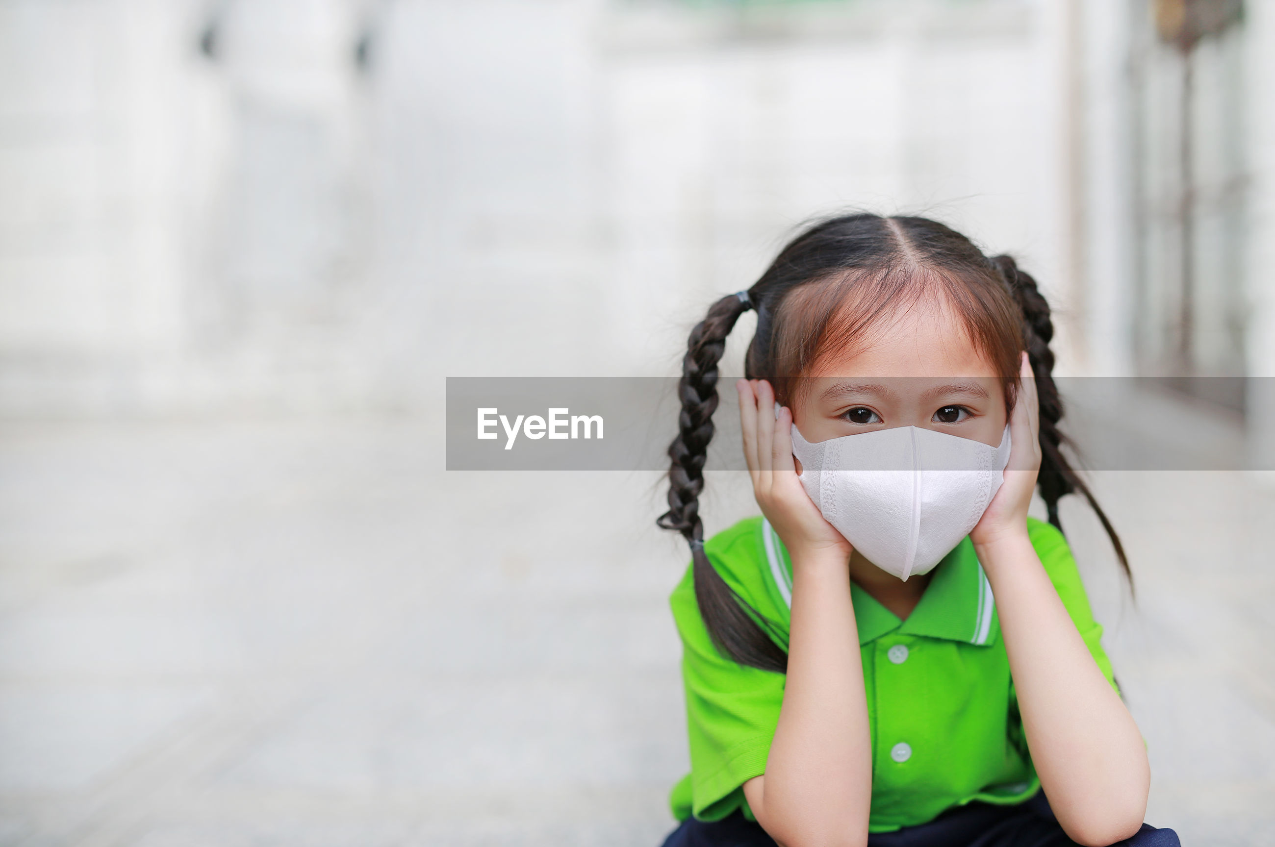 Portrait of cute girl wearing pollution mask