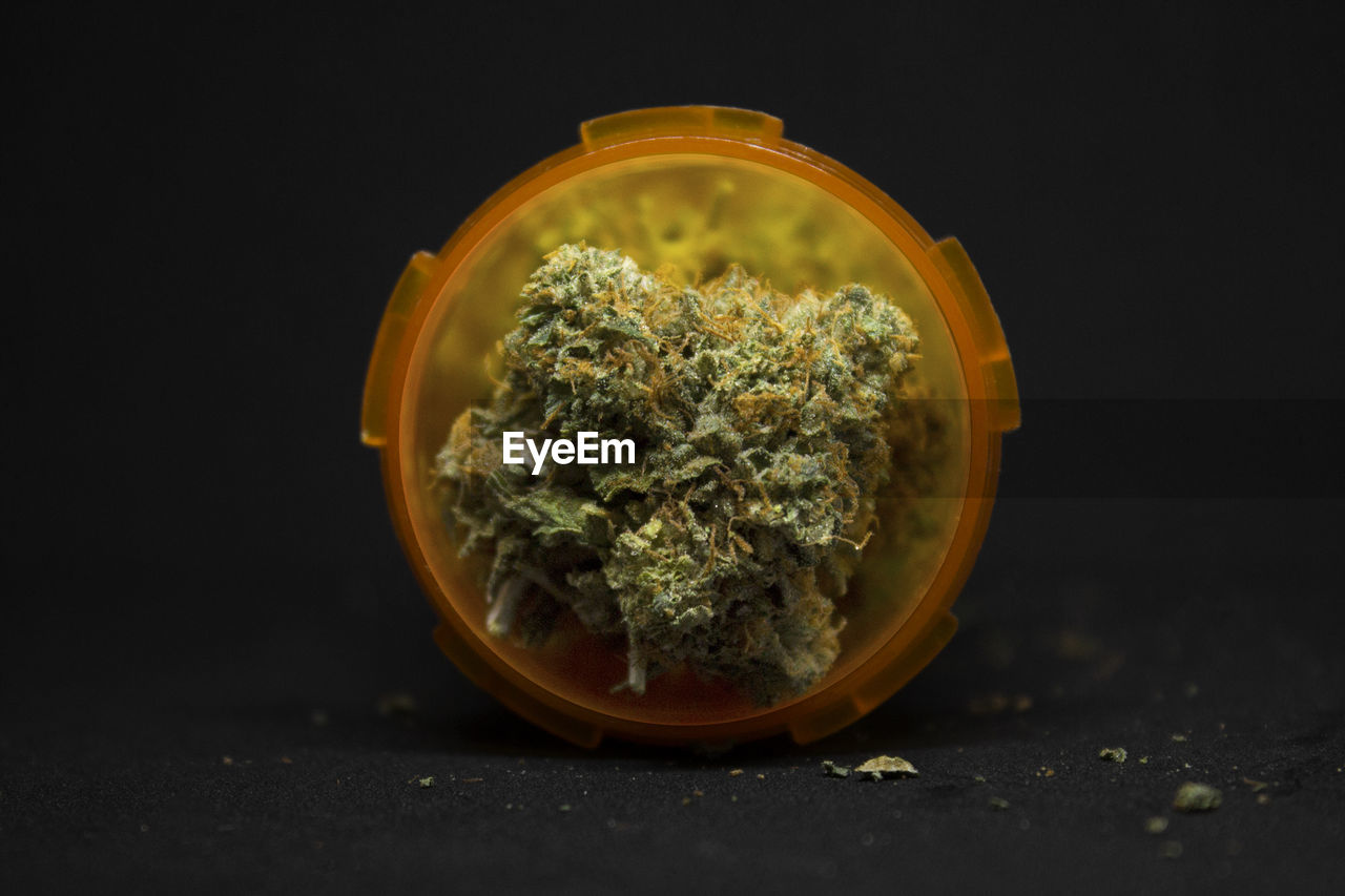 no people, marijuana - herbal cannabis, food and drink, indoors, plant, close-up, healthcare and medicine, medicine, still life, cannabis - narcotic, food, studio shot, herb, narcotic, recreational drug, herbal medicine, black background, table, cannabis plant