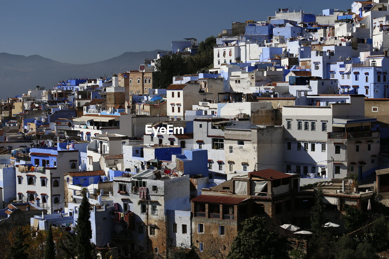 High angle view of townscape against sky, chefchaouen morocco