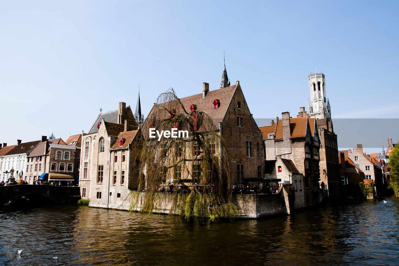 architecture, building exterior, built structure, water, canal, day, waterfront, clear sky, outdoors, history, travel destinations, sky, no people, nautical vessel