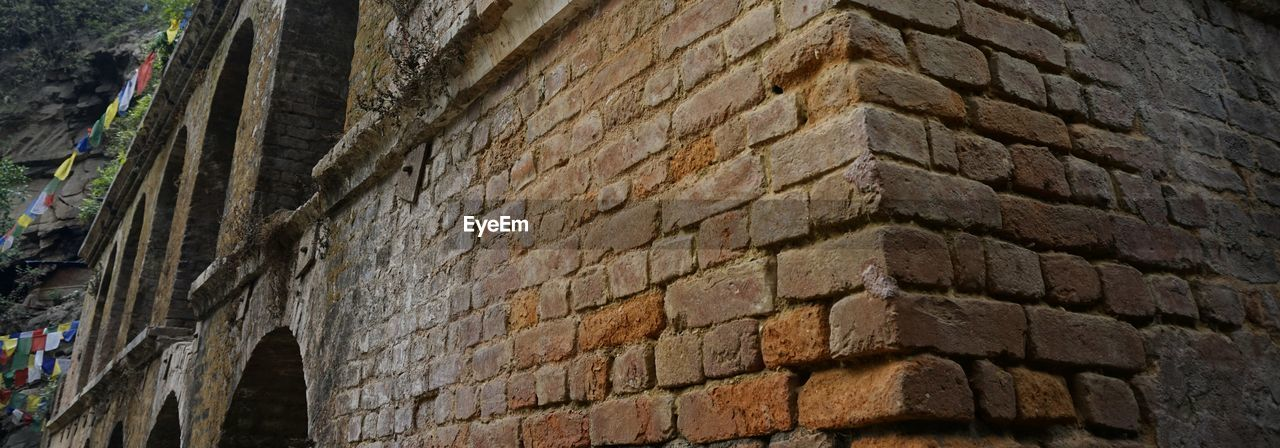 architecture, built structure, wall - building feature, brick wall, building exterior, low angle view, history, outdoors, day, no people