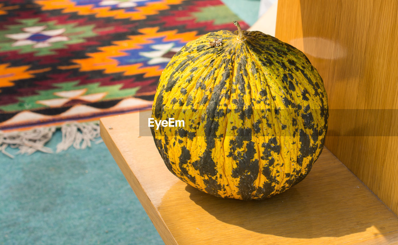 food and drink, food, healthy eating, close-up, wellbeing, still life, no people, fruit, freshness, focus on foreground, table, pumpkin, nature, wood - material, sunlight, outdoors, shadow, yellow, orange color