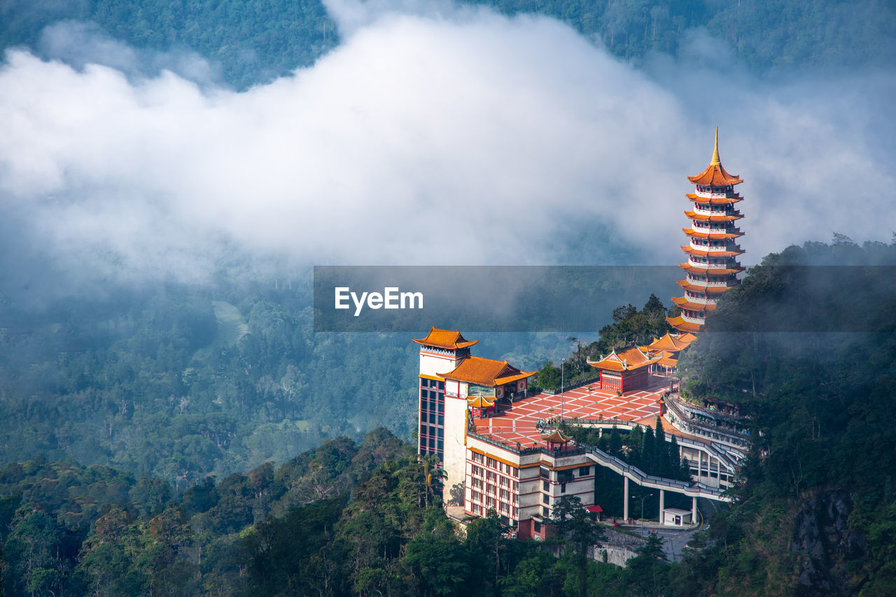 Panoramic view of buddhist temple in a forest against sky located in genting highland